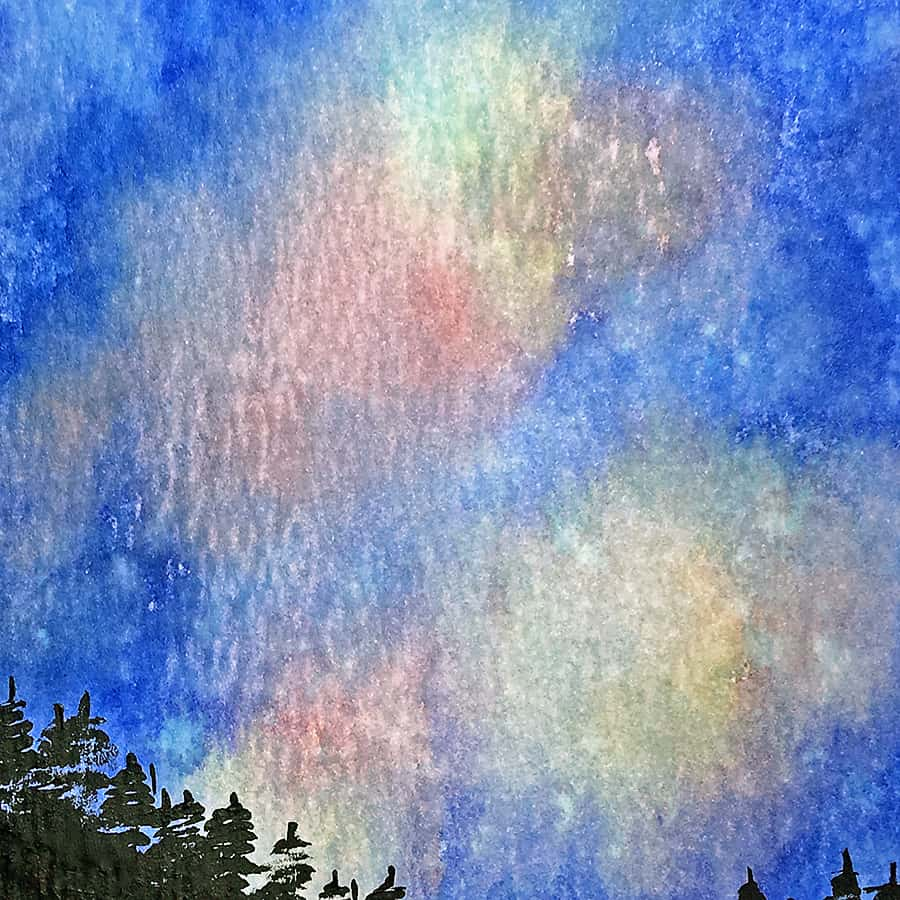 Blending distress ink and misting with water is a great way to create beautiful night sky effects.
