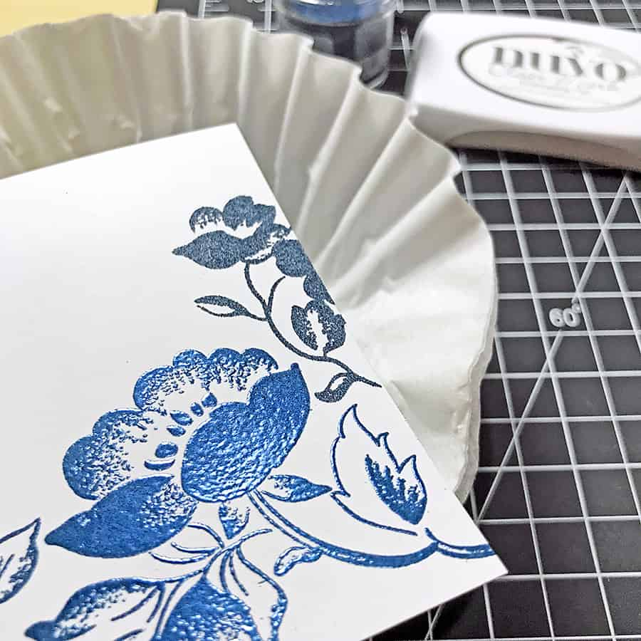 Saying Hello with Embossed Florals From Altenew - Heat embossed flower and adding the second one