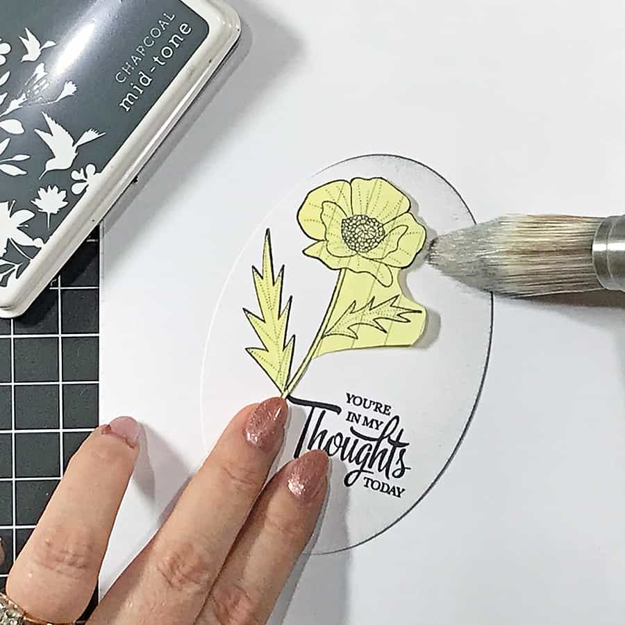 Coloring a Poppy With Copic Markers. Blending grey ink in from the edges of the oval, over a masked poppy.